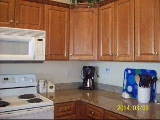 Kitchen with microwave, stove, coffee maker and lots of utensils