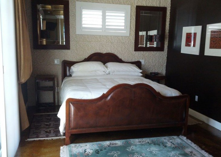 Second bedroom in master suite; king bed, TV, balcony