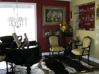 Entertain your guests with a Grand Piano on the second floor