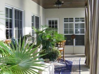 Second floor balcony off Master bedroom with privacy curtains