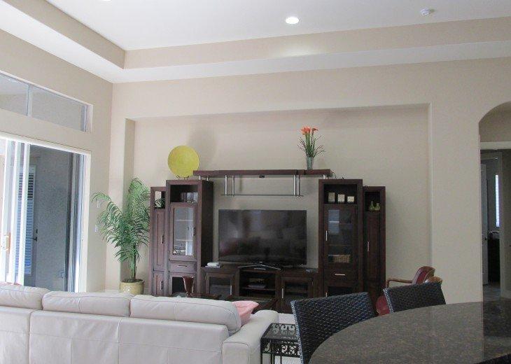 "Elegant open Great Room w/ doors to Lanai & 60"" HD TV"