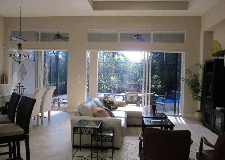 Elegant open Great Room w/ doors to Lanai & HD TV