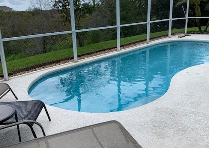 Enjoy the comforts of this affordable 4 bedroom vacation home with pool #23