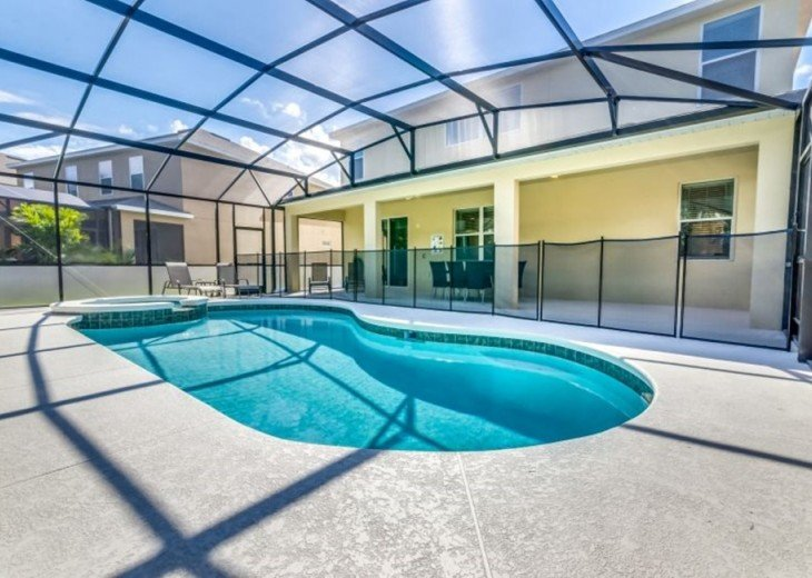 Stay in this 6, 5.5 bath vacation pool home with spa in WaterSong Resort #47