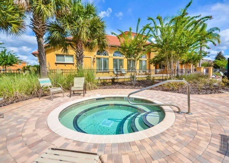 Stay in this 6, 5.5 bath vacation pool home with spa in WaterSong Resort #40
