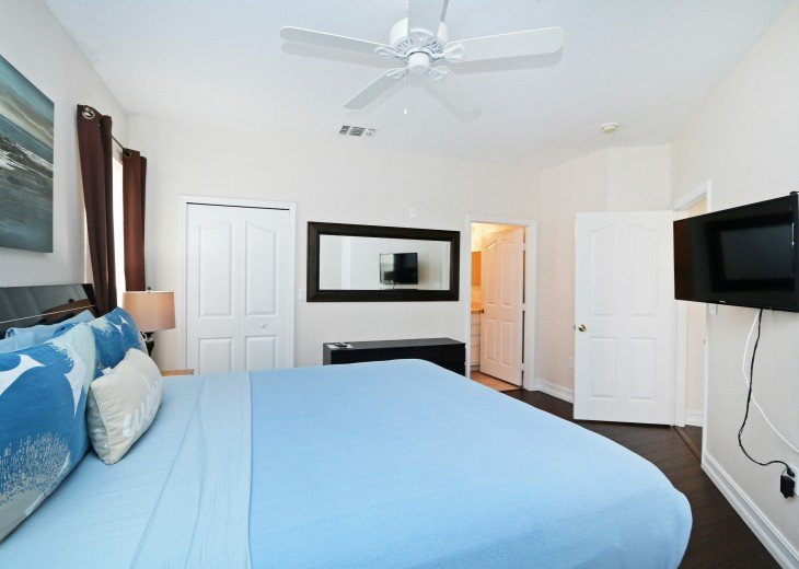 "Master Bedroom with King Bed, 39"" TV, en-suite bathroom, walk in closet"