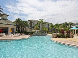 Tropical solar heated pool at Legacy Dunes with zero entry for kids