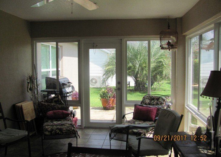 Enjoy the outside while inside. Note the grill on the open patio.
