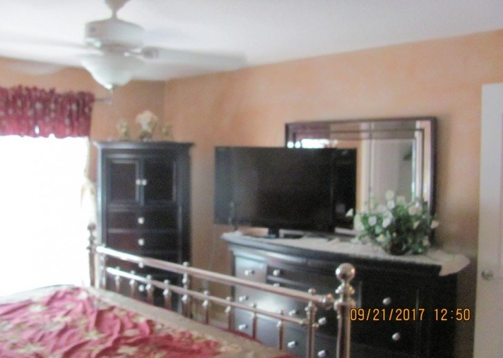 Wow...what a TV and dresser set in this master bedroom! Come and enjoy!
