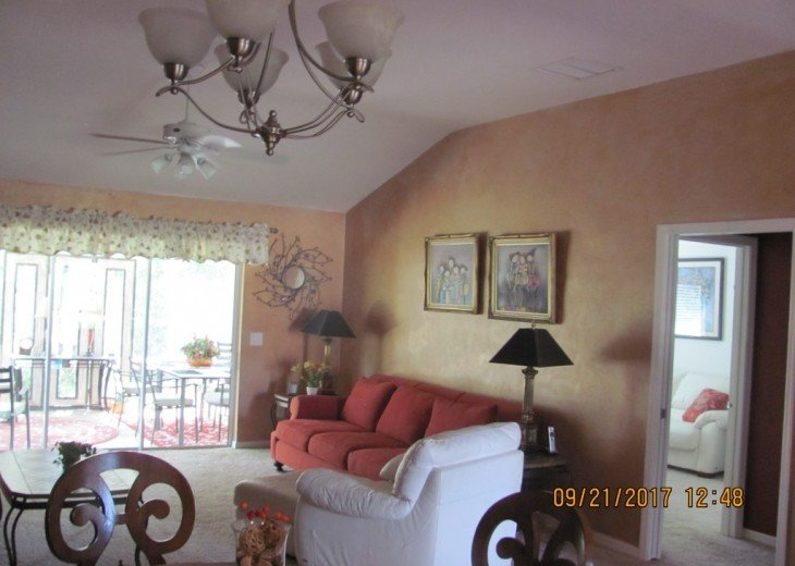 Open view of Living Room. Note sliding glass doors to the enclosed Lanai