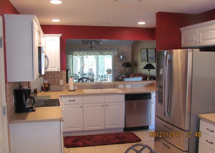 Upgraded refrigerator & open view to the outside make this an easy place to cook