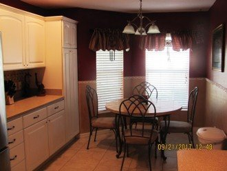 A charming bay window breakfast nook is in the kitchen area. Note the cupboards