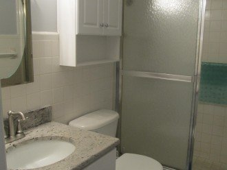 Full bathroom with stand up shower. NO Tub.