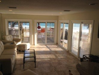 Walk right out to Deck and Beach/sliders have blinds built in Windows
