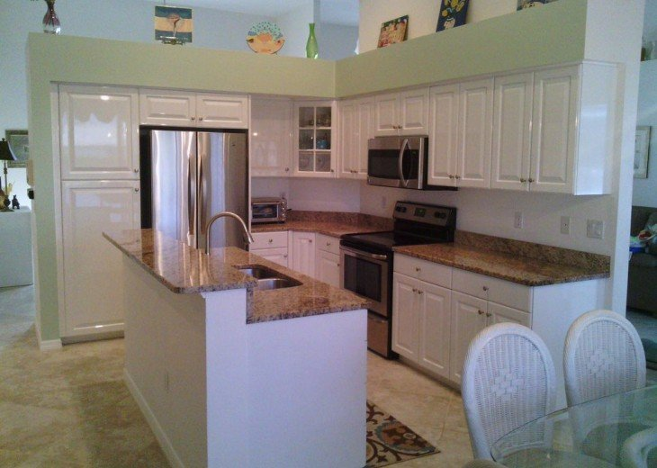 Beautiful Kitchen with Stainless Steel Appliances & Granite Counter Top