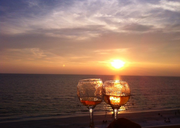 Cheers at sunset from the balcony