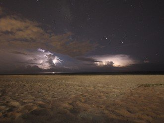 View from the beach of a storm approaching