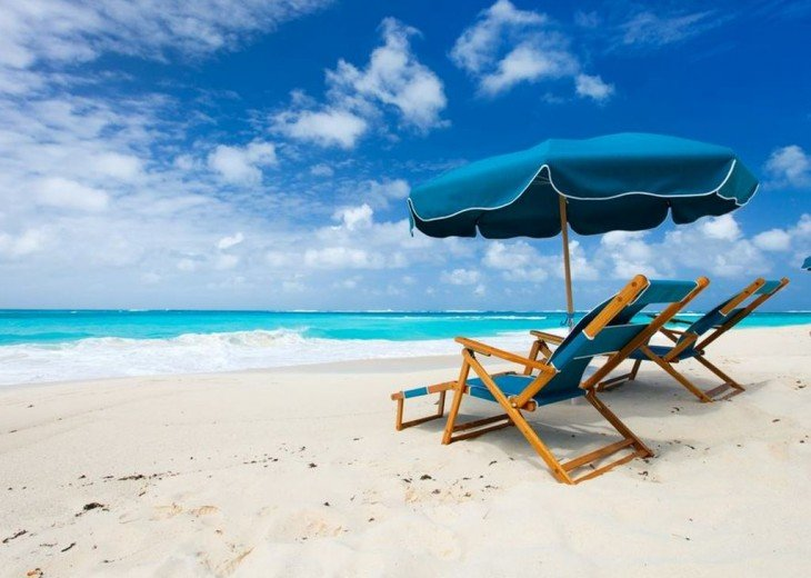 Enjoy Free Beach Set Up - 2 Chairs and Umbrella - Just for You. Saves $30 a day