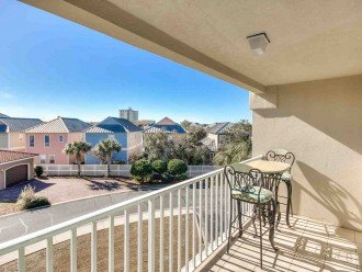 Enjoy a Peaceful Beachside Neighborhood View from the Balcony