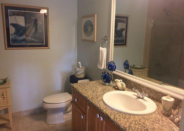 Second master bedrroms private bathroom has sailfish enclosure.