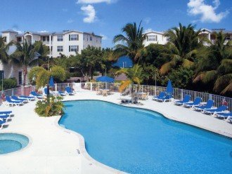 Tropical heated pool & hot tub just steps from our beautiful condo!
