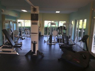 Complex's fitness center. Next to tennis courts and pool.
