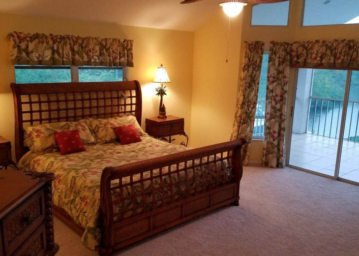 Master bedroom w/ king bed and private balcony overlooking the point