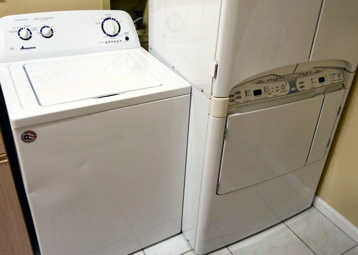 Large laundry room with utility sink, washer and dryer