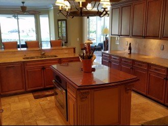 Premium kitchen with custom woodwork and upgraded appliances