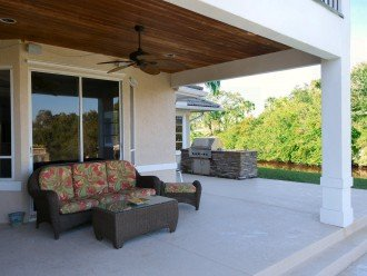 Large covered porch area between grill, pool and point - hang out outside even o