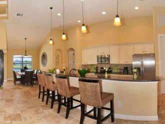 Spacious kitchen with stainless steel appliances and granite countertops