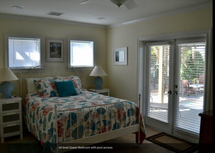 ground floor queen bedroom with full bathroom and pool access