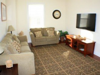 """living room with 55"""" mounted TV"""
