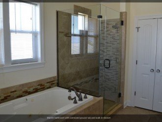 walk in shower with jacuzzi tub and closet