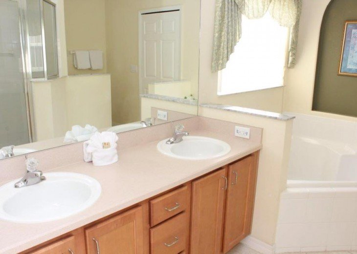 King Master Bath with soaking tub and separate large walking shower
