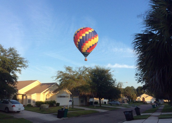Hot air balloons fly over the house early on weekends
