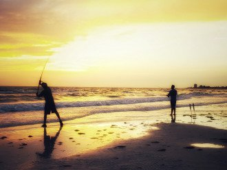 Fishermen on our Crescent Beach at Sunset .