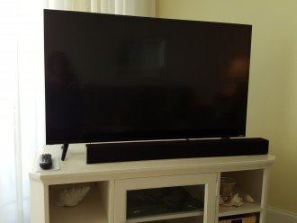 NEW - 50 inch, ultra high definition TV, and home theater sound bar.