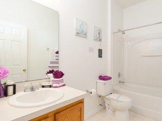 Queen bathroom with over bath shower
