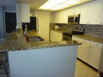Kitchen with new granite and backsplash
