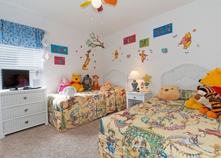 Winnie the Pooh themed twin with toys and dress up clothes