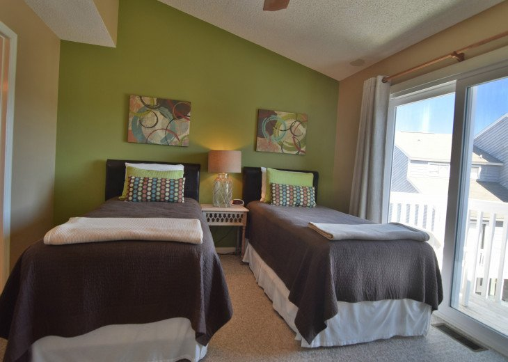 2 twin size beds with private full bath