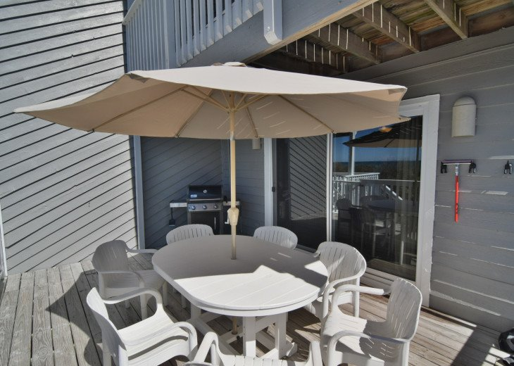 Large outdoor dining table and new Weber grill