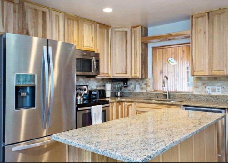 Kitchen Island, granite. Lots of storage in the kitchen.