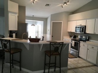 Portion Of Kitchen, And Breakfast Bar