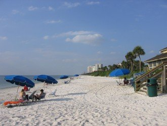 Private Beach at Pelican Bay with chairs and umbrellas included
