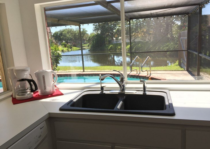 View of pool (and lake) from kitchen sink