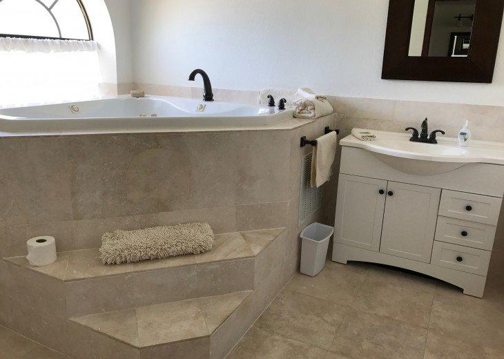 Master bedroom hot tub corner bath.
