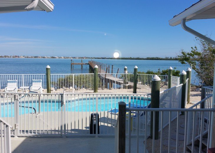 View of pool and dock as you walk out the slider door.