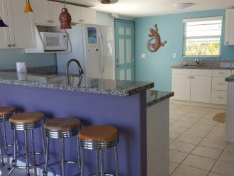 The large kitchen has 2 separate sinks, and 2 refrigerators with ice makers.